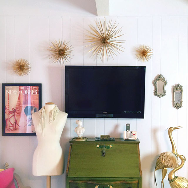 Wall with TV and four gold starburst wall art pieces from midcentury DIYs