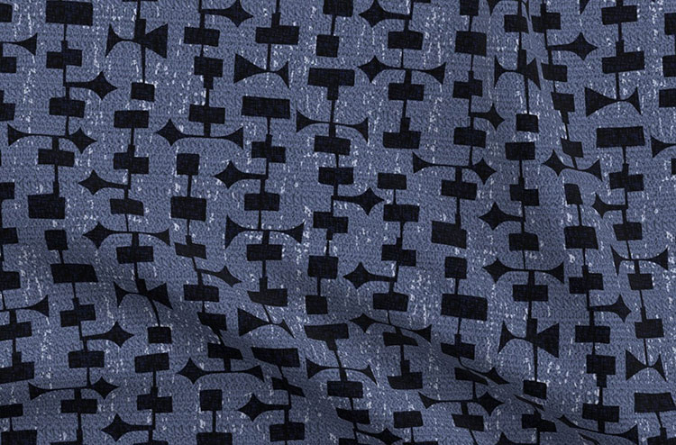mod style fabric with navy blue background and black googie style patter overlay