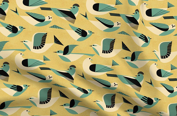 fabric with charley harper style bird illustrations on a mustard background