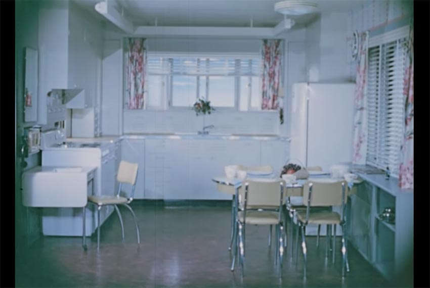 a still of a 1950s kitchen from a historical 1950s video about the design of an efficient kitchen