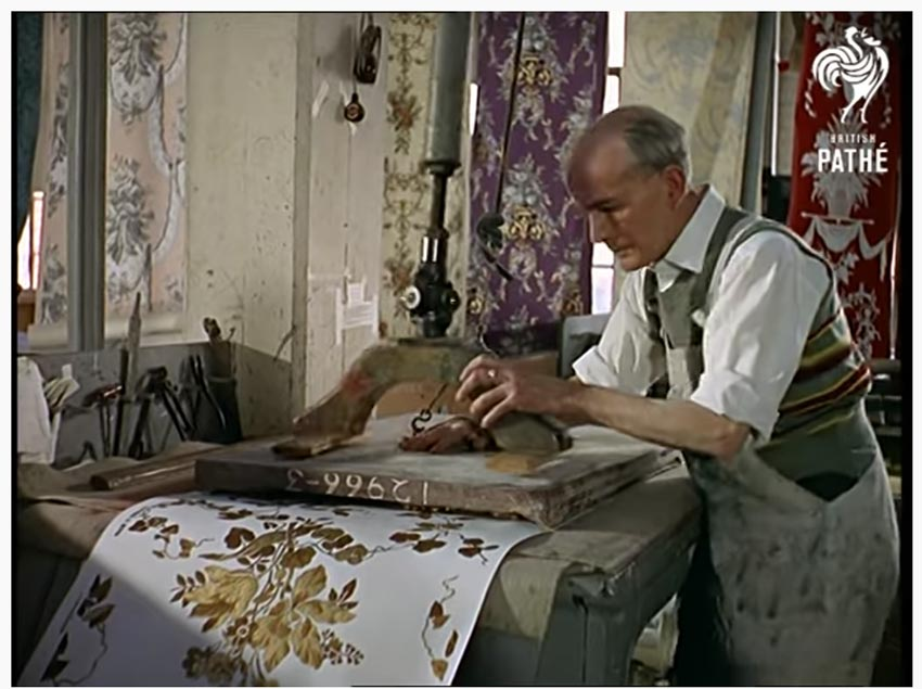colored still from a historic mid century video about wallpaper making