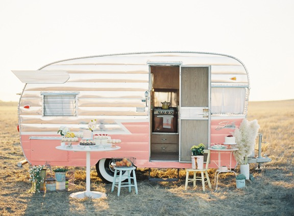 Vintage trailer with pink aluminum flashing