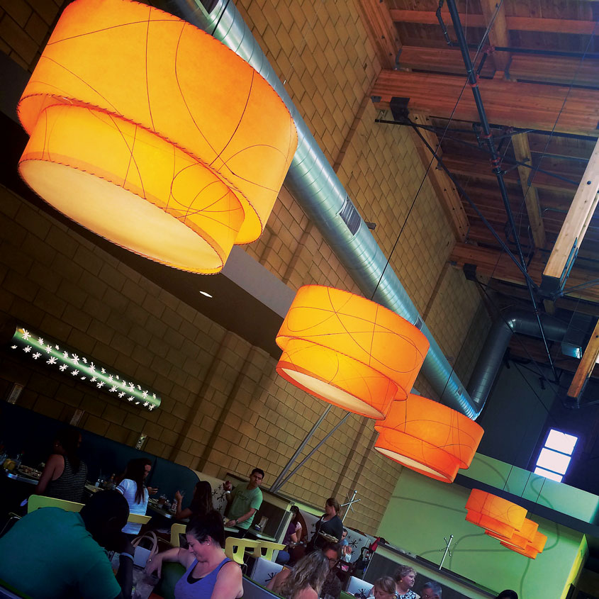 double drum pendants hung in the dining room of an Austin eatery.