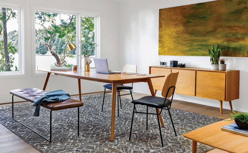 a mid century style dining room with Artivle dining table, wire-frame chairs and bench