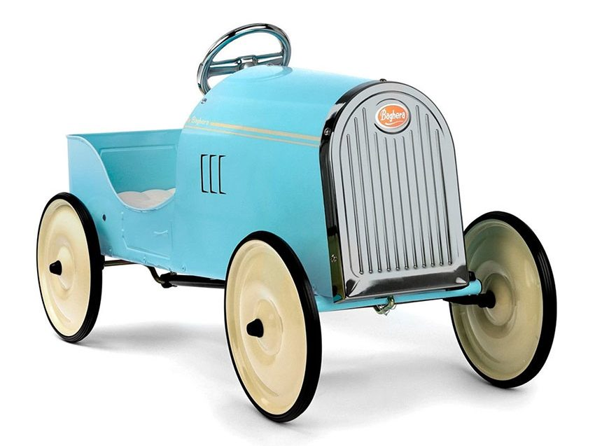 A miniature car with a turquoise metal frame, chrome wheel and font, and large cream wheels with black trim.