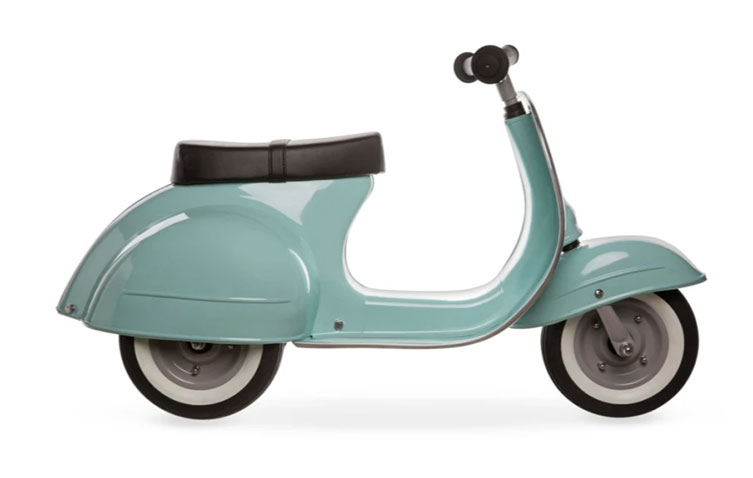 A child's sized seafoam green retro vespa-like scooter