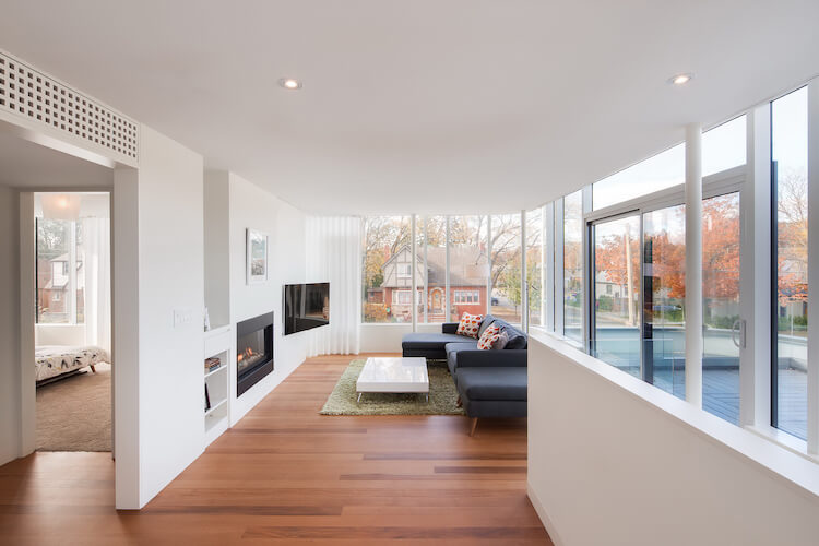 Living room with glass paneled walls and fireplace