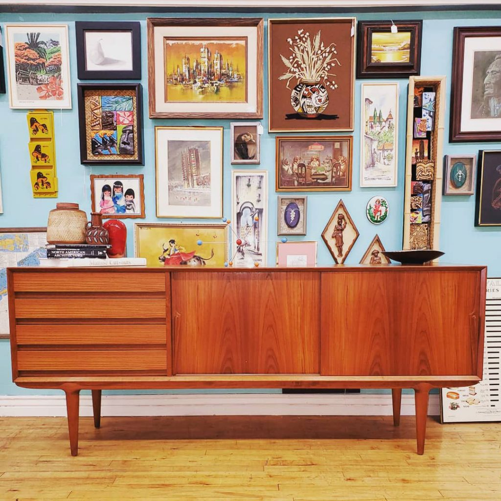 Mid Century Modern credenza under gallery wall art from the 50s and 60s