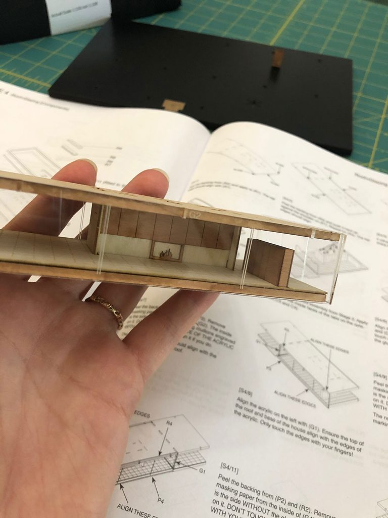 mid century modern model Farnsworth House kit in progress with tiny fireplace