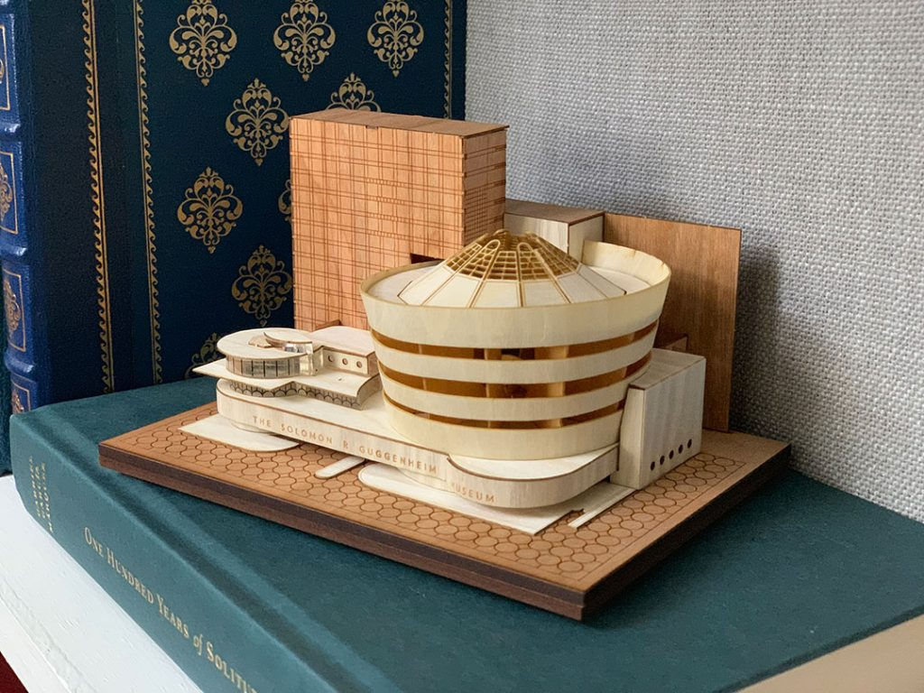 Guggenheim Museum Model Kit made of wood on top of a book