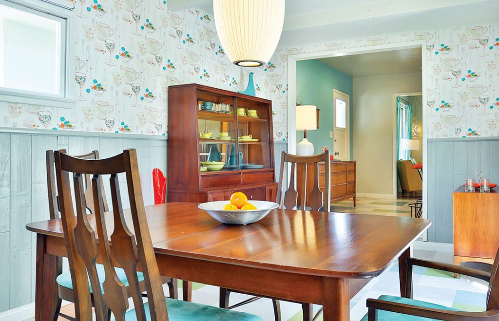 retro mid century modern dining room with light blue wallpaper and
