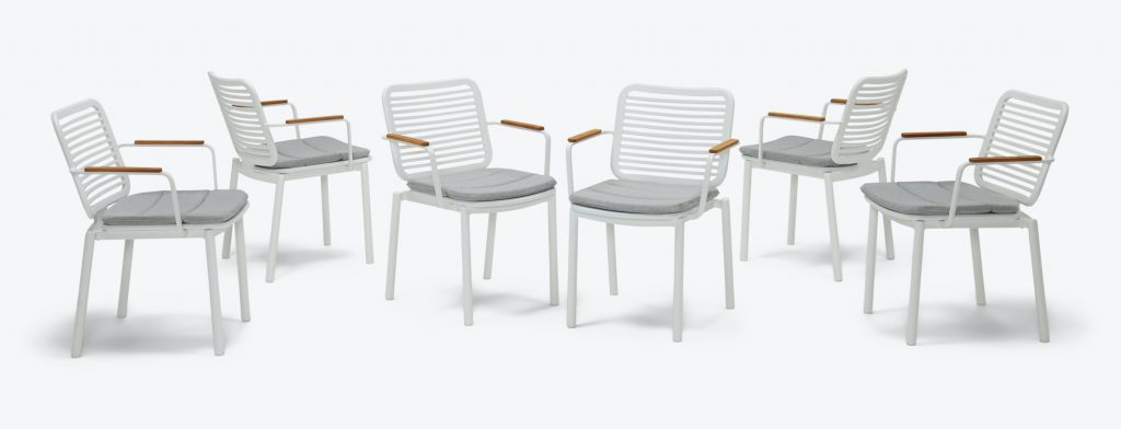 patio furniture dining chair set with white slat back design and wooden armrests