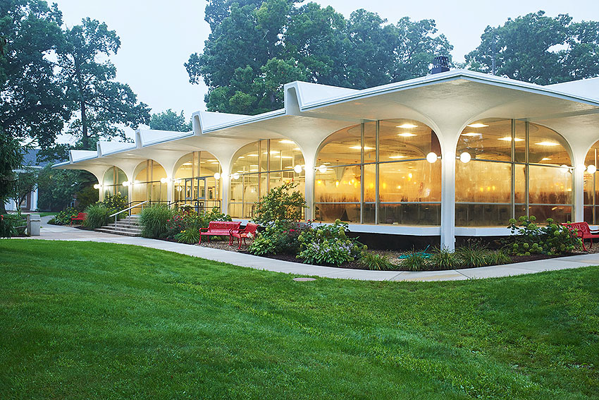 michigan modernism as seen in the Lester K Kirk Center with large glass walls framed by a biomorphic arched pavillion