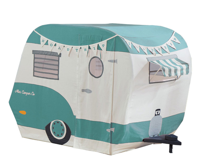 <ALT TEXT: A canvas playhouse in the shape of a retro camper with blue and cream coloring and bunting across the top.