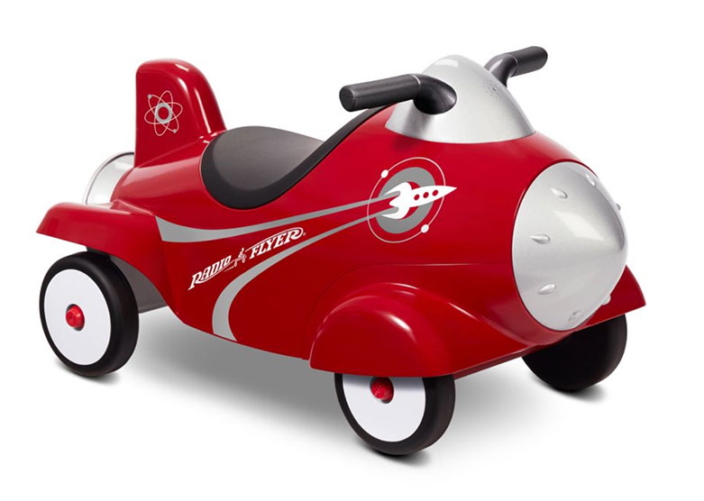 Child's size red push car shaped like a retro red rocket.