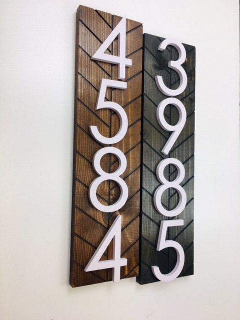 white house numbers mounted on wood plaques perfect for a mid century modern patio