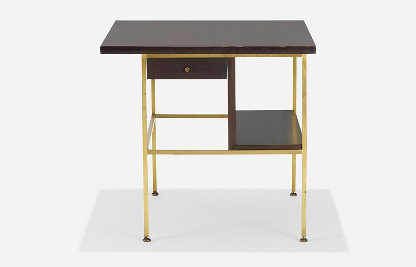 An occasional table from the Irwin Collection for Calvin boasts a signature mix of brass and wood with a modular organization.