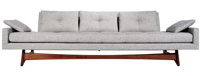 A gray, minimally tufted Adrian Pearsall sofa with wooden legs.