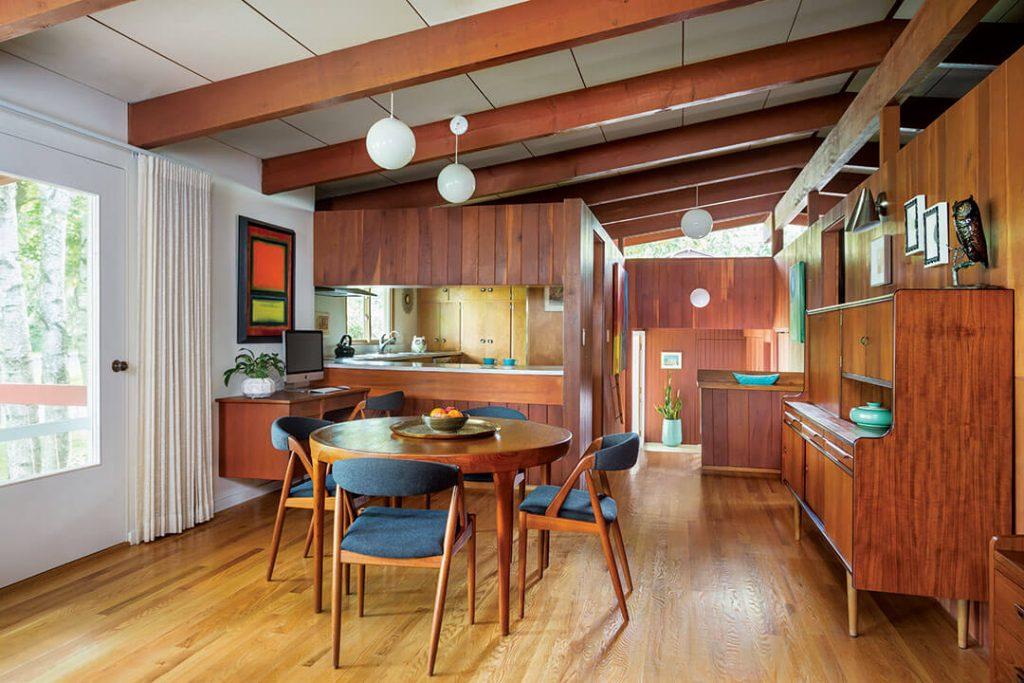 A mid century modern dining area displaying a blend of wood tones for proper use of oil finishes