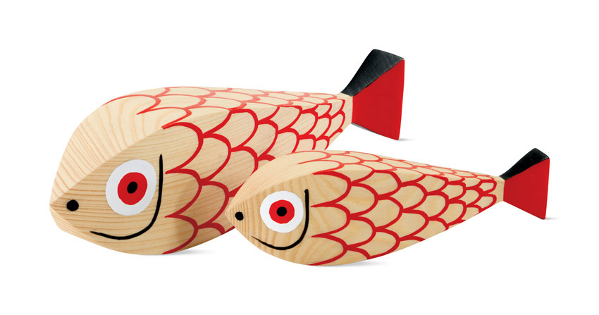 wooden fish with red, white and black painted designs such as scales and a face