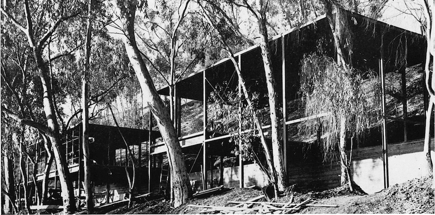 A black and white photograph showing the structure during construction.
