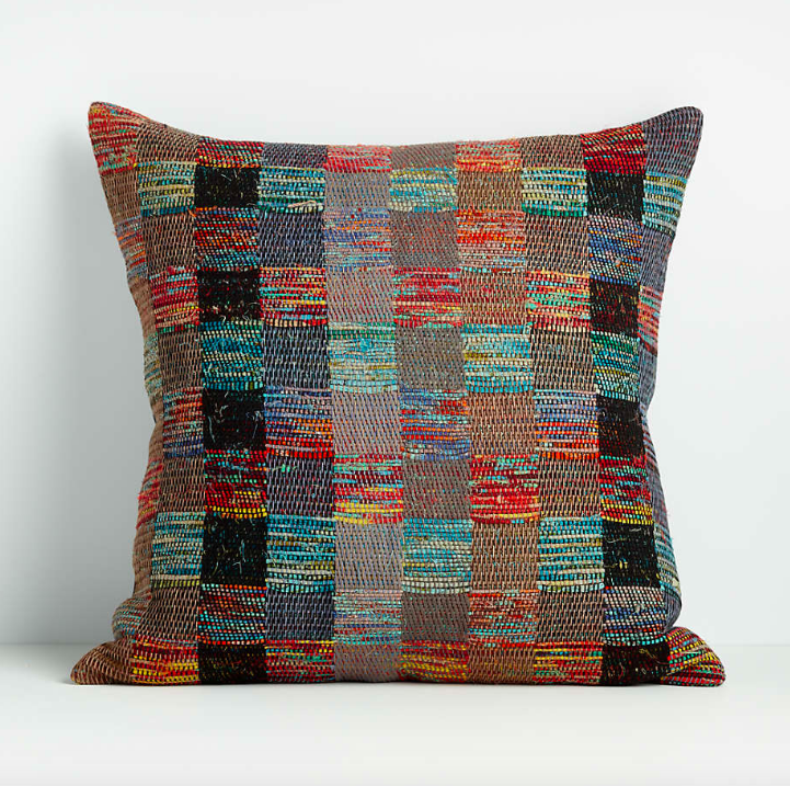 Checkered and multi-colored pillow in teals, reds and browns.