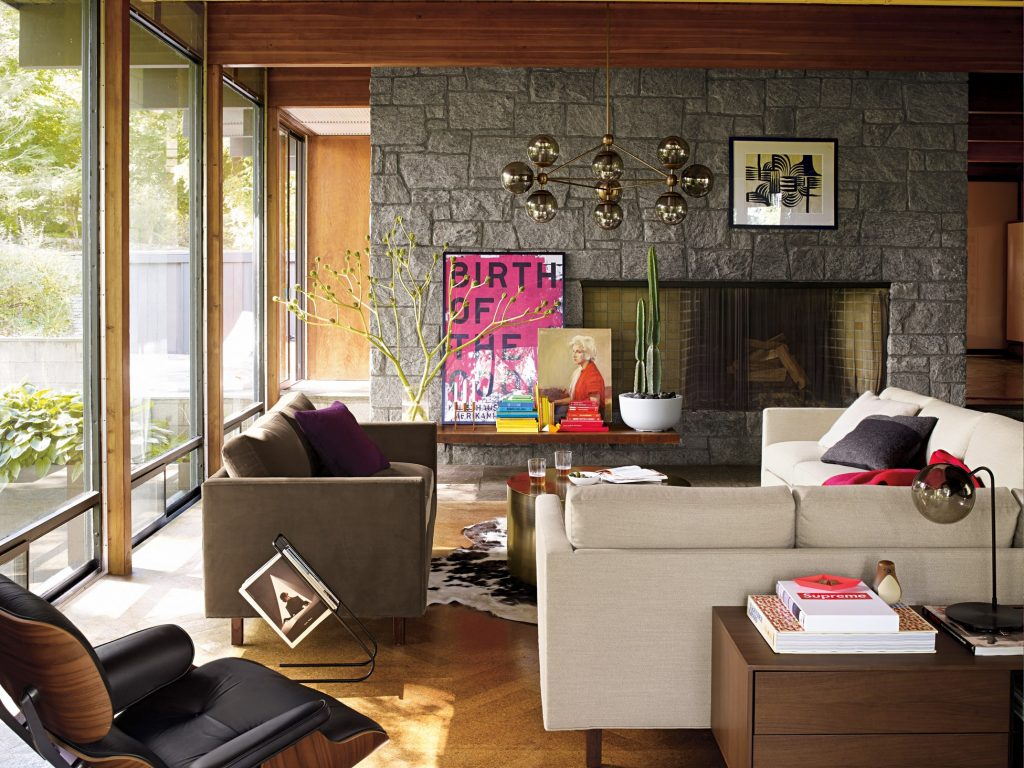 Milo Baughman's Goodman sofa in a mid cengtury modern living room with a stone fireplace.