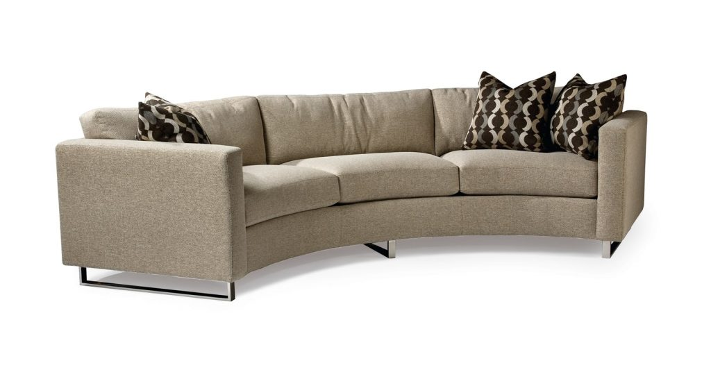 Circular sofa in tan with black pillows