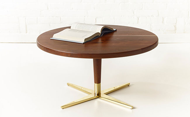 pedestal style mid century modern style coffee table