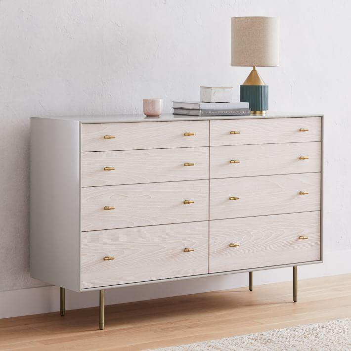 white washed wooden mid century style dresser