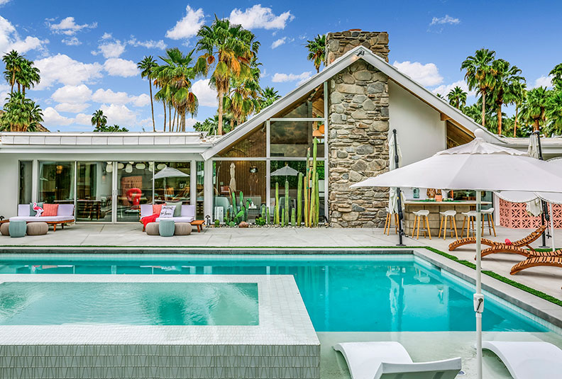 the backyard of a charles du bois in palm springs with a pool