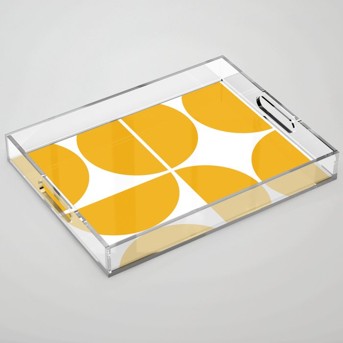 A clear acrylic rectangular tray has two cutouts for handles and the bottom is a white background with mustard colored half-circles.