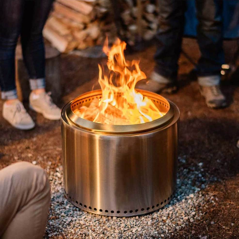 chrome modern fire pit that is wood burning
