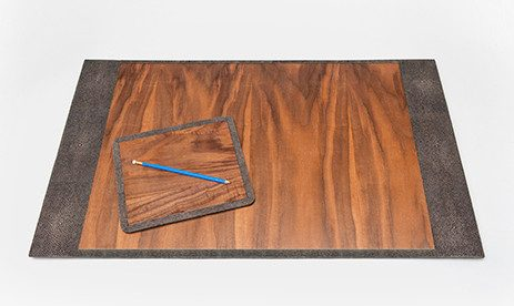 mid mod office supplies: A small wood veneer mouse pad sits on top of a large rectangular desk blotter with wood veneer.>