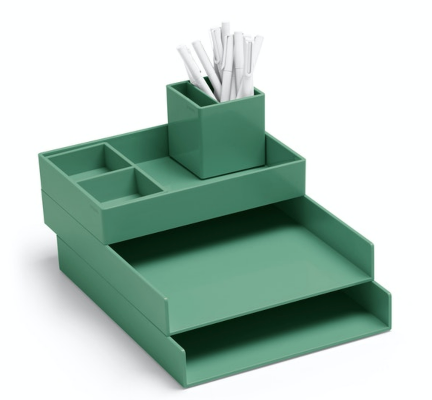 A sage green desk organizer with 4 separate compartments that stack on top of each other