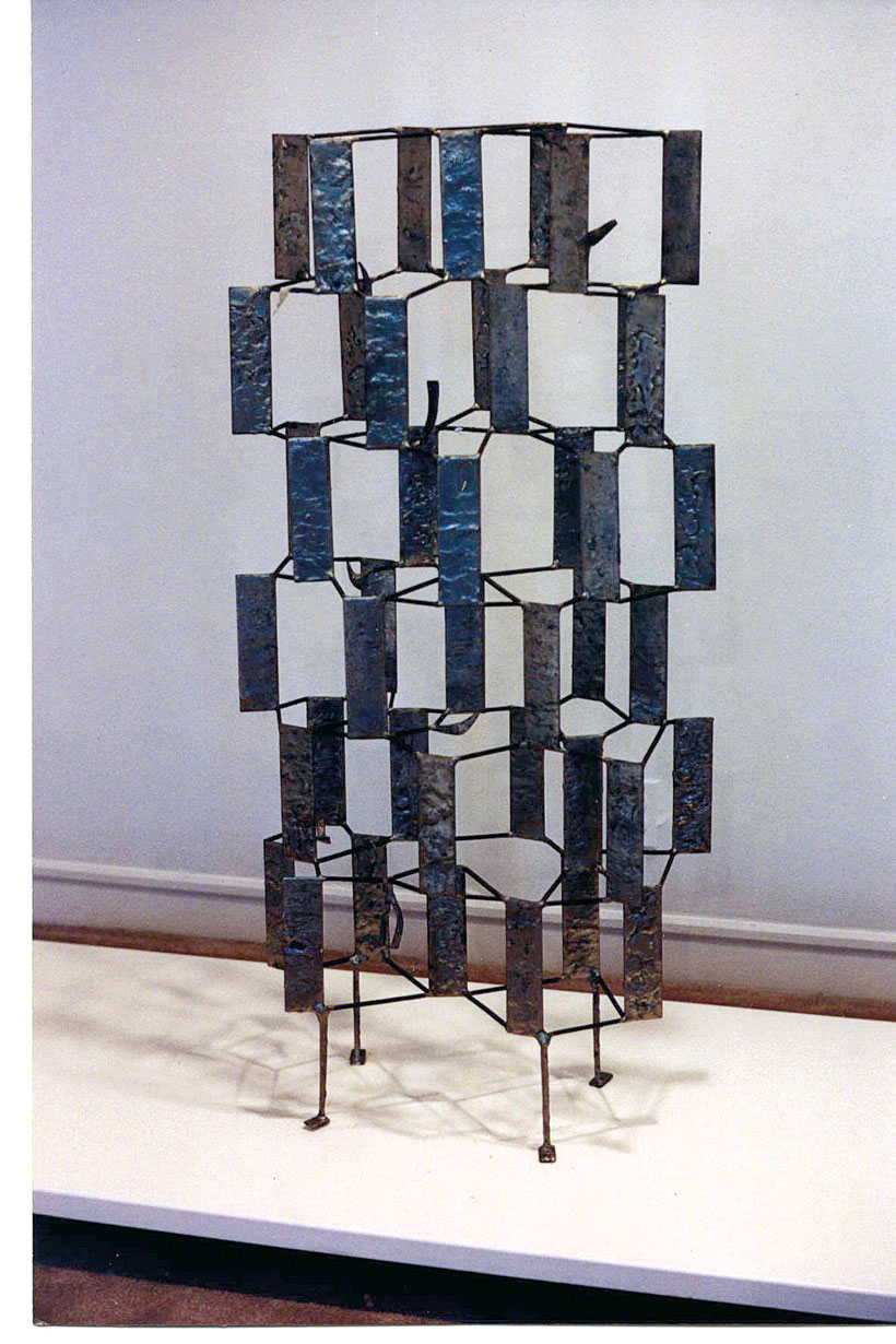 Standing metal sculpture made of stacked rectangles
