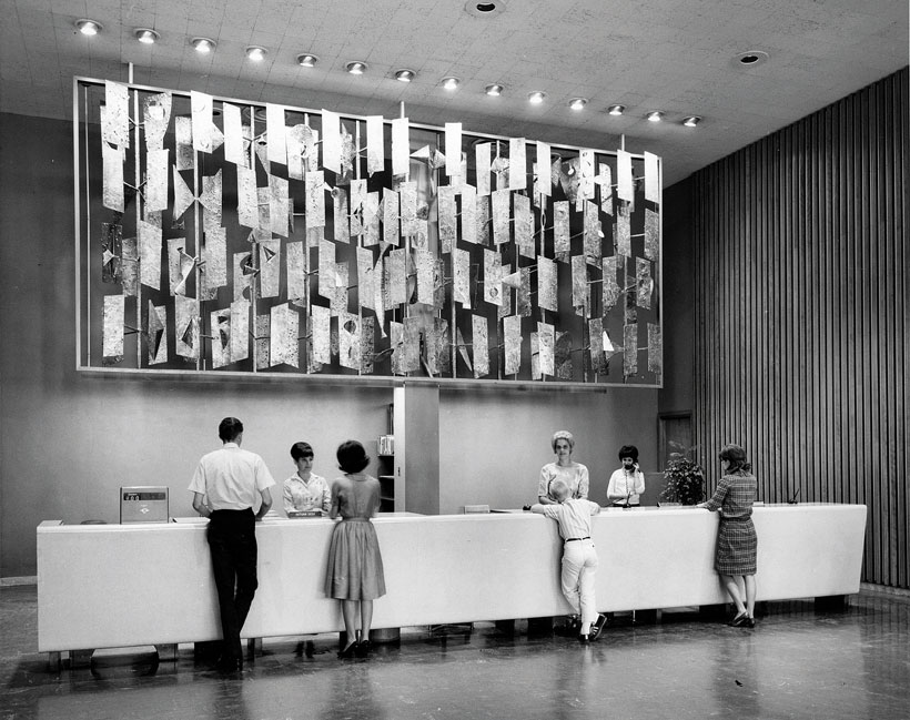 People admire the works of Harry Bertoia at a gallery.
