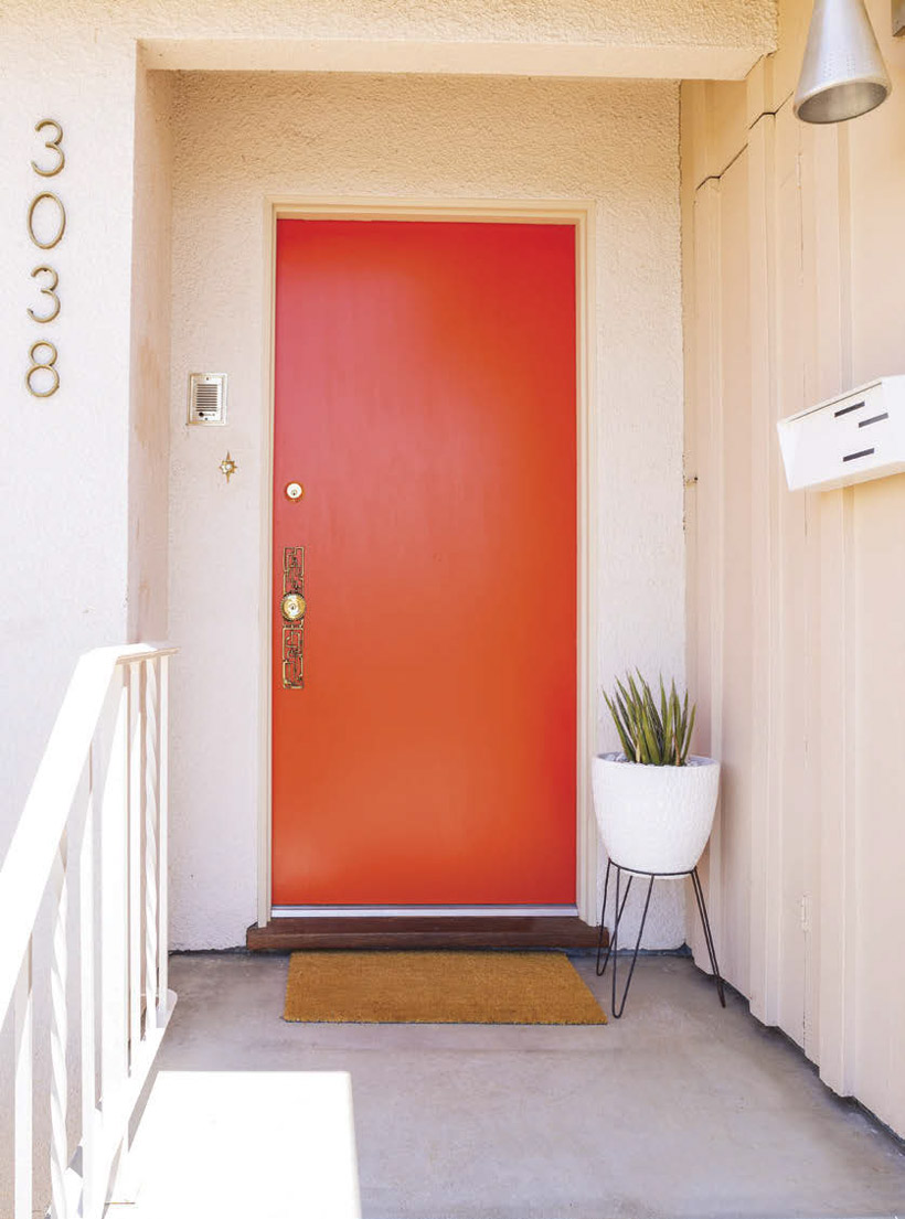 One of Palm Springs' doors, a simple but vibrant orange house door.