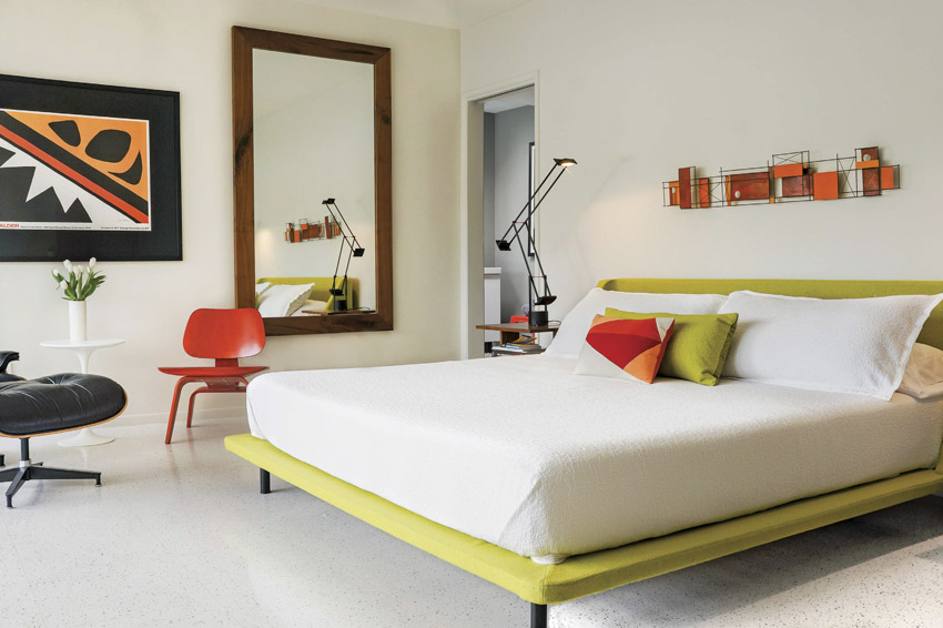 The master bedroom has a lime green bed frame with orange and red accents.