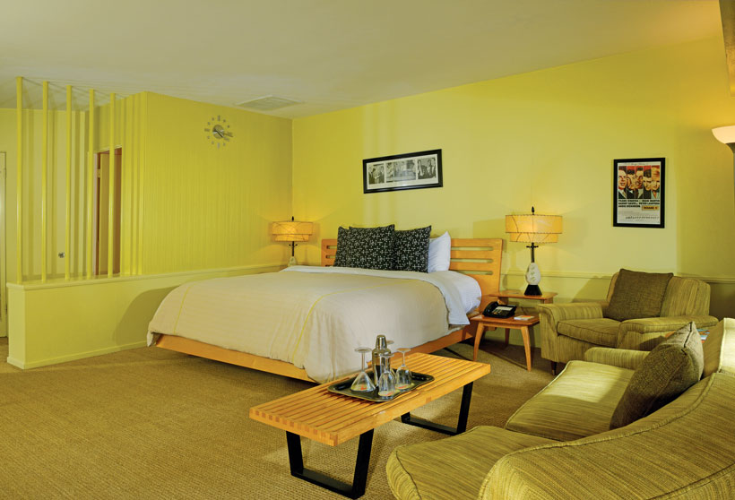 Retro hotel room has a monochromatic yellow color scheme.