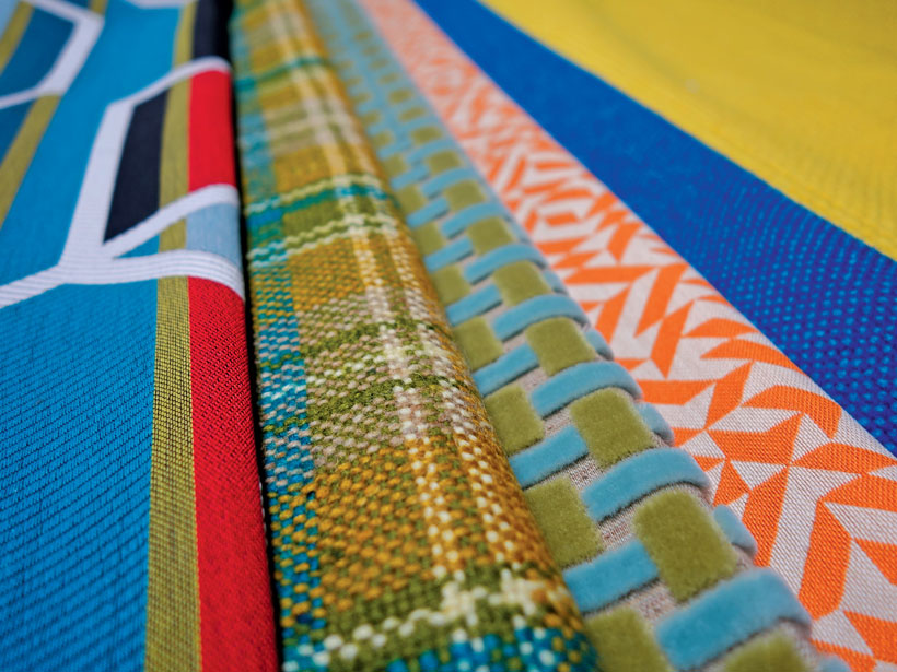 Up-close shot of thick, high quality patterned fabrics.