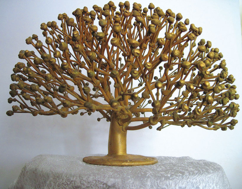 Small muted brass tree with rounded branch ends.