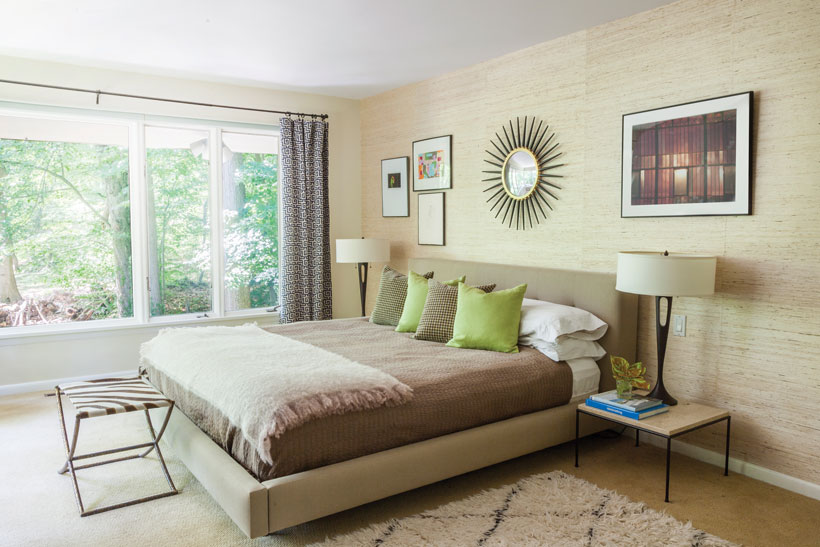 The master bedroom has a neutral color palette and mid century modern decor.