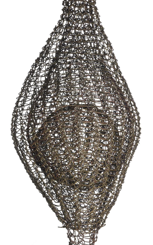 Ruth Asawa's intricate metal sculpture within a sculpture.
