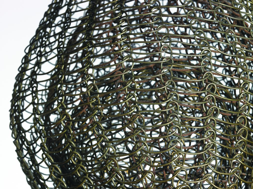 Close-up of wire sculptures within a wire sculpture.