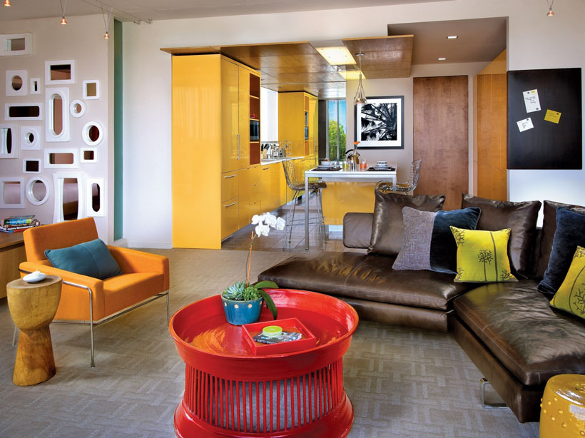 Retro hotel living room with mismatched modern furniture pieces.