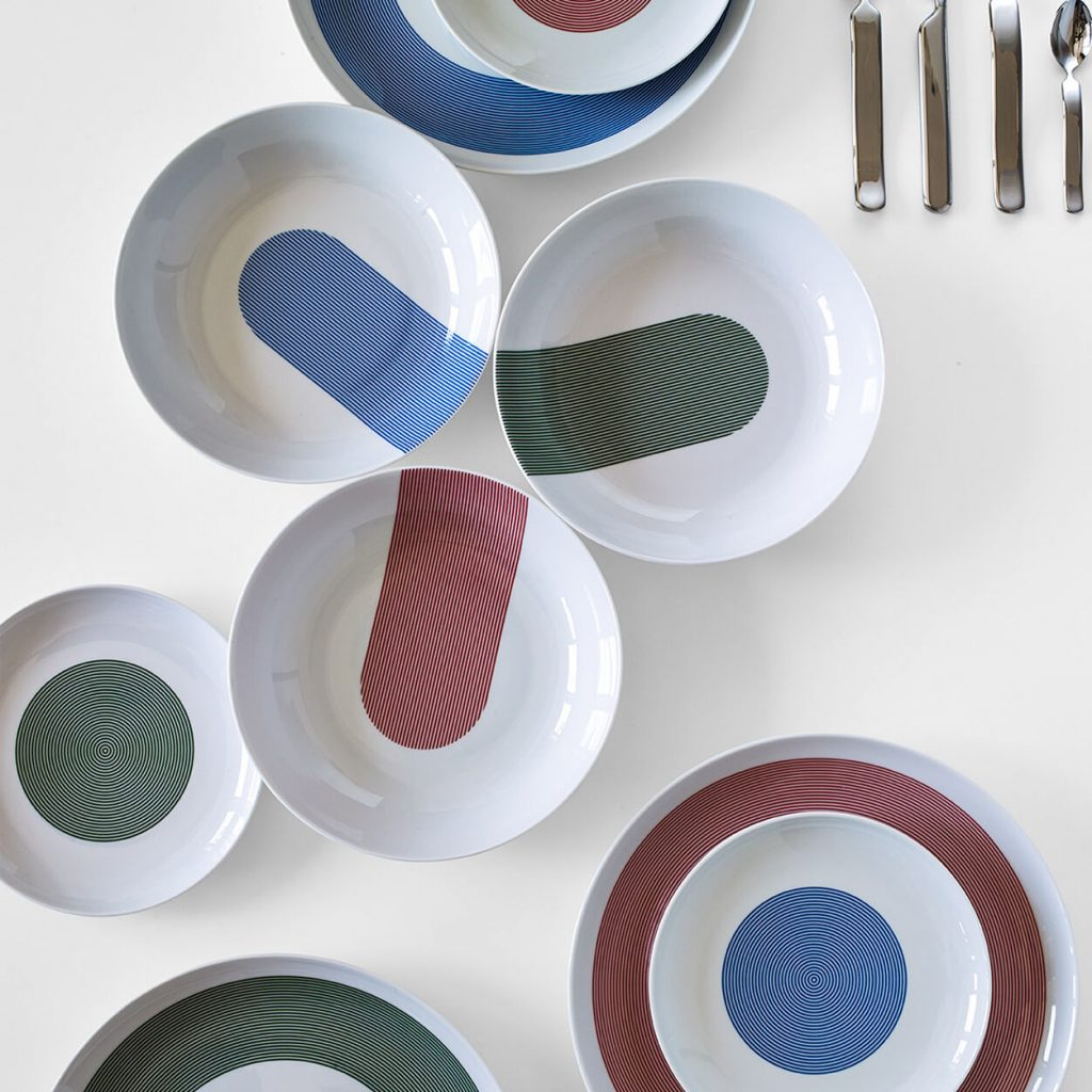 white dinner set with blue red and green graphic