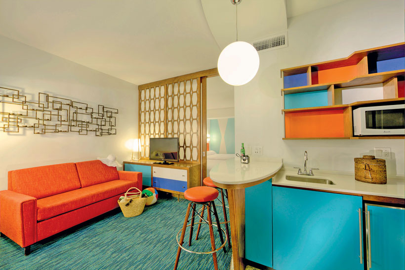 Brightly-colored mid century kitchenette in a retro hotel.