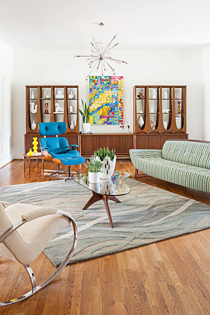 Mid century home safety living room with furniture and wood cabinets