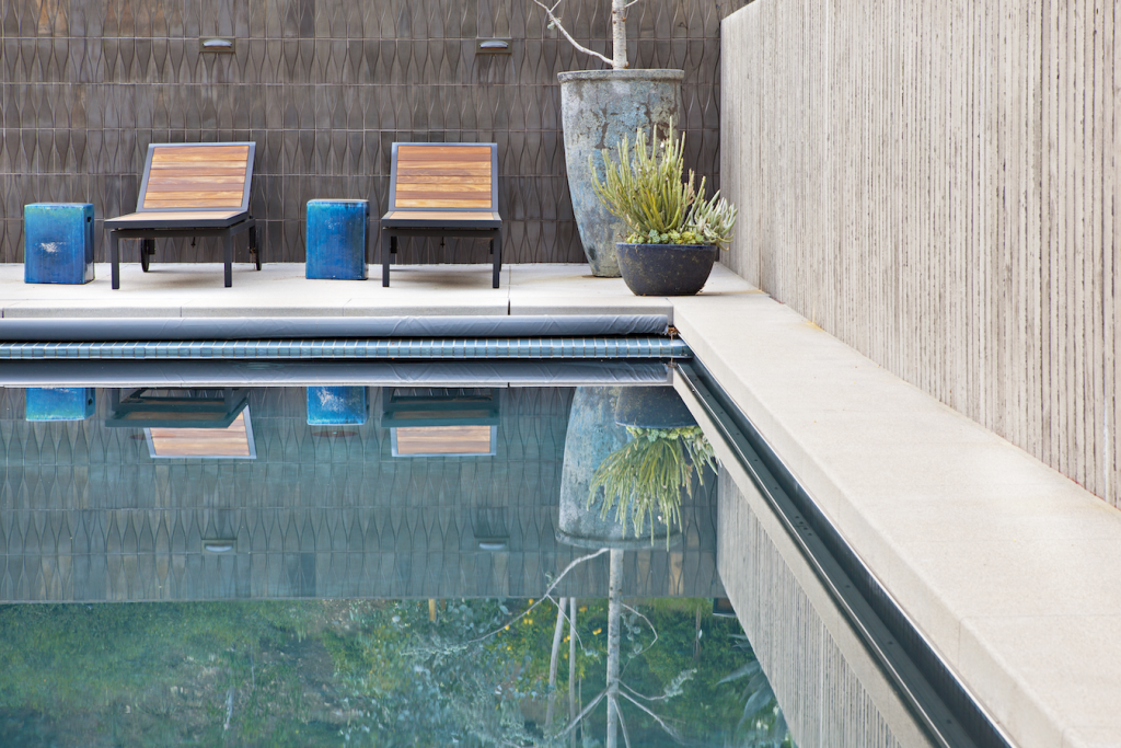 mid century pool with retaining wall and outdoor tile